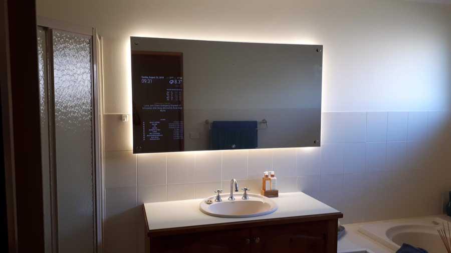 Large smart mirror in bathroom